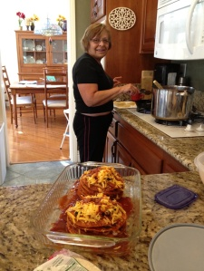 Phyllis showing me how to make the best enchiladas. Click photo or link for recipe...