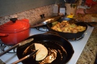 Tortillas in the oil, onions and potatoes almost finished.