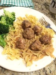 Swedish Meatballs swimming in perfect gravy, served with broccoli.