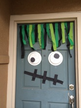 Hide your weather beaten front door behind a Door Monster this Halloween!