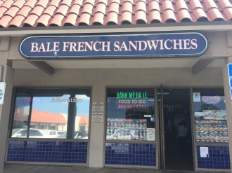 The lovely mom, showcasing the Bale French Sandwich shop.