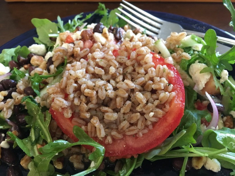 Recipe: Farro Stuffed Tomato on Arugula with Black Beans and Feta